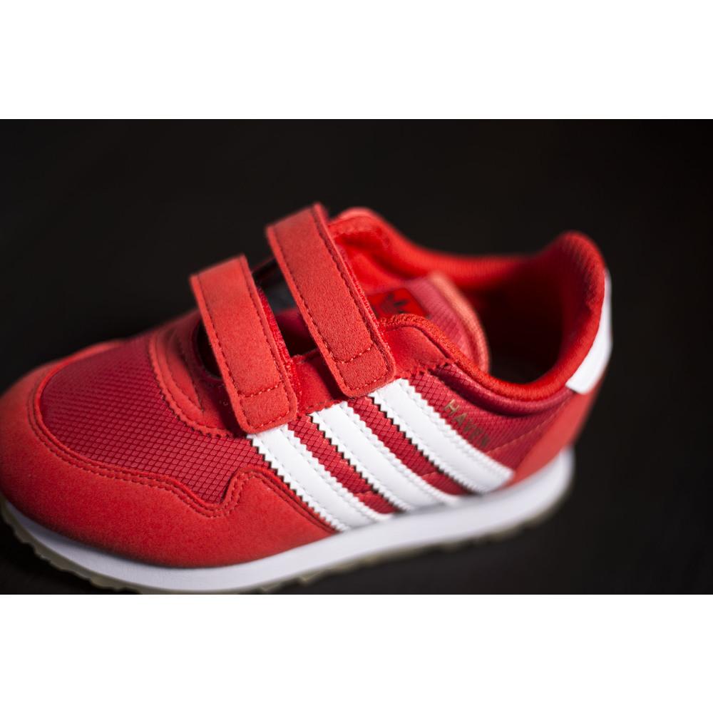 44da26f04e8af Detské červené tenisky Adidas Haven s bielou podrážkou a s upevnením ...